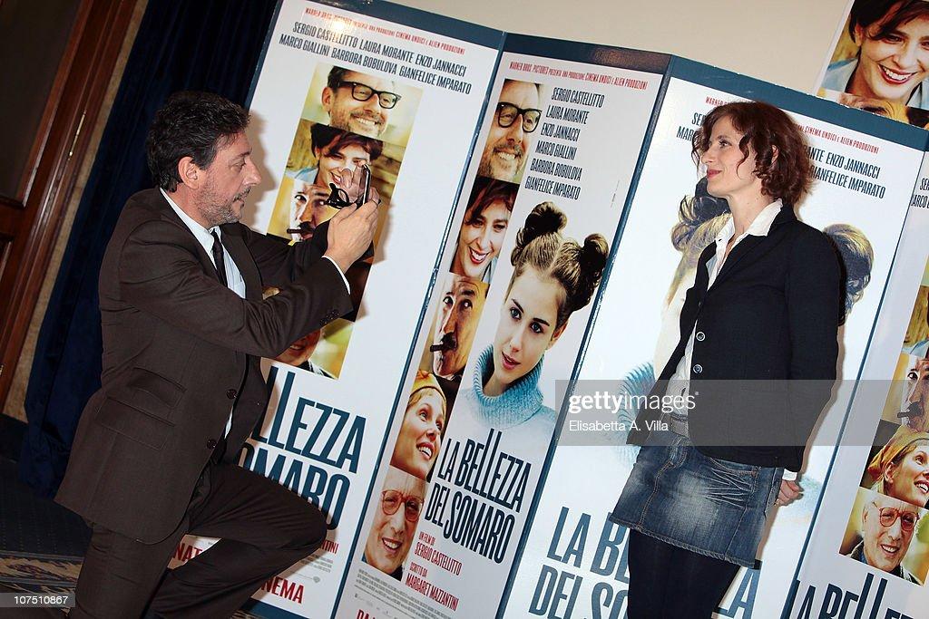 Actor / director Sergio Castellitto (L) and writer Margareth Mazzantini attend 'La Bellezza Del Somaro' photocall at the Bernini Bristol Hotel on December 10, 2010 in Rome, Italy.