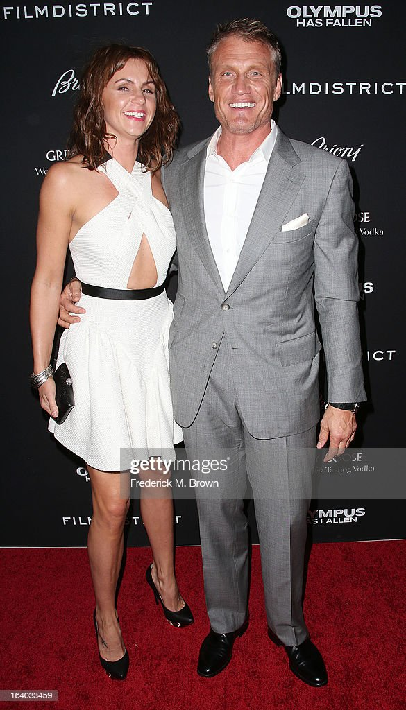 Actor Dolph Lundgren (R) and his guest attend the Premiere of FilmDistrict's 'Olympus Has Fallen' at the ArcLight Cinemas Cinerama Dome on March 18, 2013 in Hollywood, California.