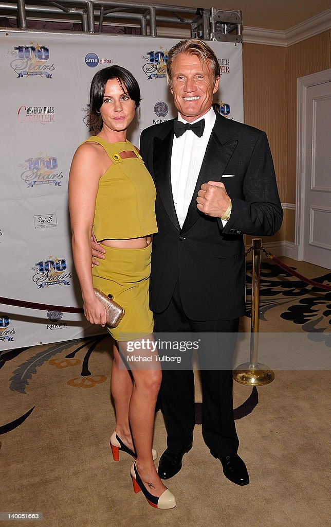 Actor Dolph Lundgren and Jenny Sandersson arrive at Norby Walters' 22nd Annual Night Of 100 Stars Viewing Gala at the Beverly Hills Hotel on February 26, 2012 in Beverly Hills, California.