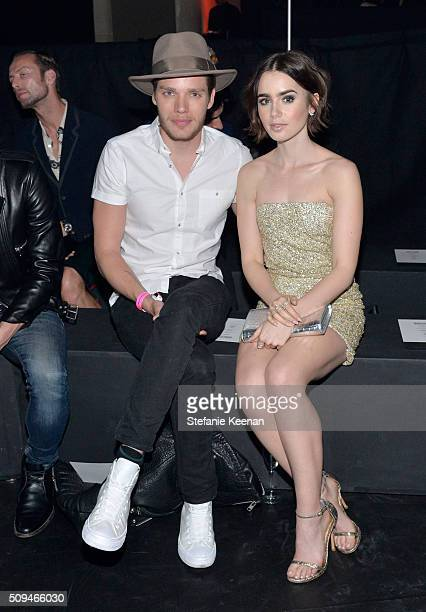 Actor Dominic Sherwood and actress Lily Collins both in Saint Laurent by Hedi Slimane attend Saint Laurent at the Palladium on February 10 2016 in...
