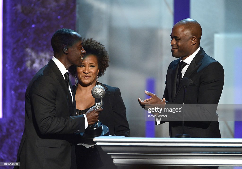 Actor Don Cheadle (L) accepts Outstanding Actor in a Comedy Series award for 'House of Lies' from TV personalities Wanda Sykes and Wayne Brady onstage during the 44th NAACP Image Awards at The Shrine Auditorium on February 1, 2013 in Los Angeles, California.