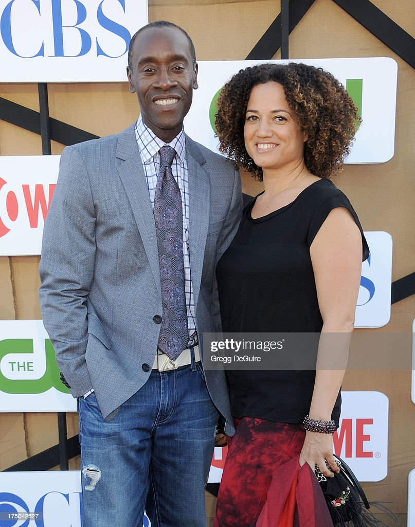 Actor Don Cheadle and Bridgid Coulter arrive at the CBS/CW/Showtime Television Critic Association's summer press tour party at 9900 Wilshire Blvd on July 29, 2013 in Beverly Hills, California.
