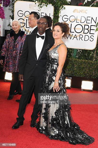 Actor Don Cheadle and guest attend the 71st Annual Golden Globe Awards held at The Beverly Hilton Hotel on January 12 2014 in Beverly Hills California