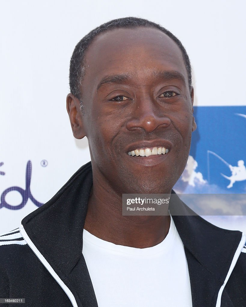 Actor <a gi-track='captionPersonalityLinkClicked' href=/galleries/search?phrase=Don+Cheadle&family=editorial&specificpeople=202096 ng-click='$event.stopPropagation()'>Don Cheadle</a> attends the 4th annual Milk+Bookies story time celebration at The Skirball Cultural Center on March 10, 2013 in Los Angeles, California.