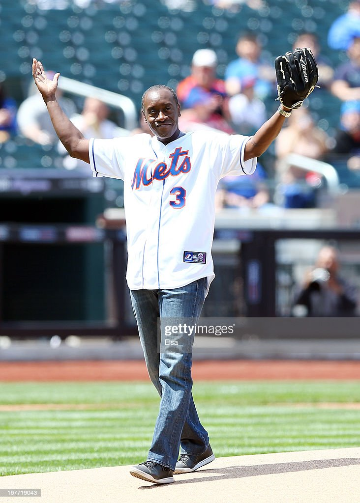 Actor Don Cheadle celebrates after he threw out the ceremonial first pitch before the game between the New York Mets and the Philadelphia Phillies on April 28, 2013 at Citi Field in the Flushing neighborhood of the Queens borough of New York City.