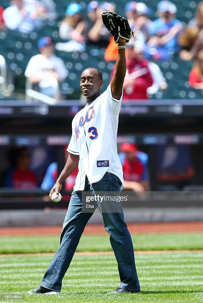 Actor Don Cheadle greets the fans before he throws out the ceremonial first pitch before the game between the New York Mets and the Philadelphia Phillies on April 28, 2013 at Citi Field in the Flushing neighborhood of the Queens borough of New York City.