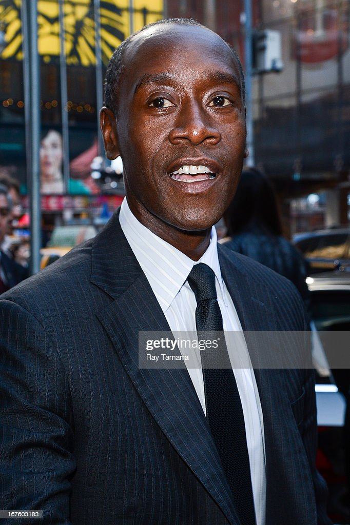 Actor Don Cheadle leaves the 'Good Morning America' taping at the ABC Times Square Studios on April 26, 2013 in New York City.