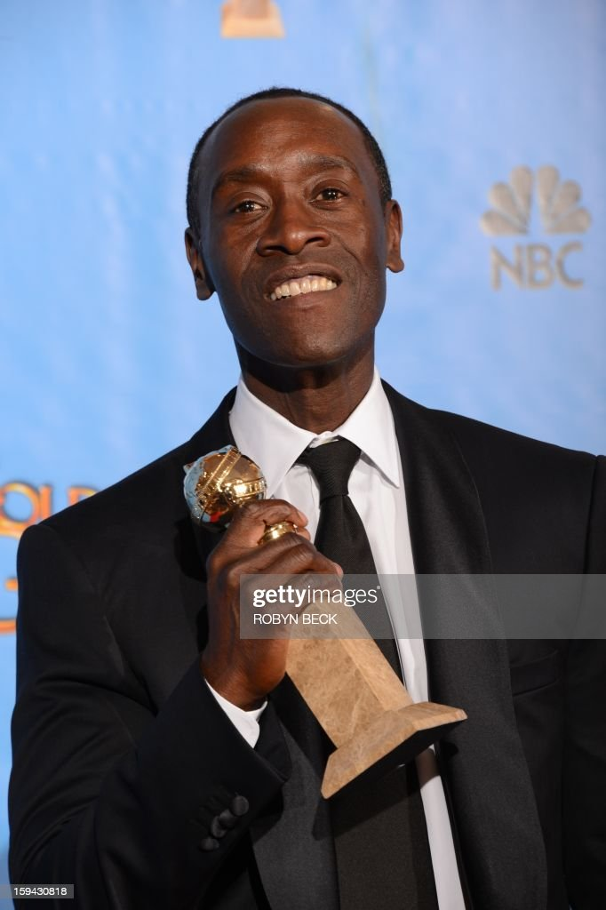 Actor Don Cheadle poses in the press room with his Best performance by an actor in a television comedy or musical series award for 'House of Lies' at the Golden Globes awards ceremony in Beverly Hills on January 13, 2013. AFP PHOTO/Robyn BECK