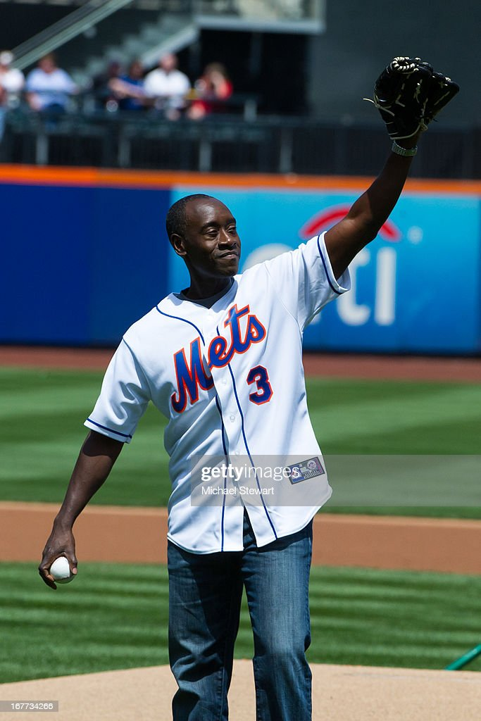 Actor Don Cheadle throws out the first pitch before the Philadelphia Phillies vs New York Mets game at Citi Field on April 28, 2013 in New York City.