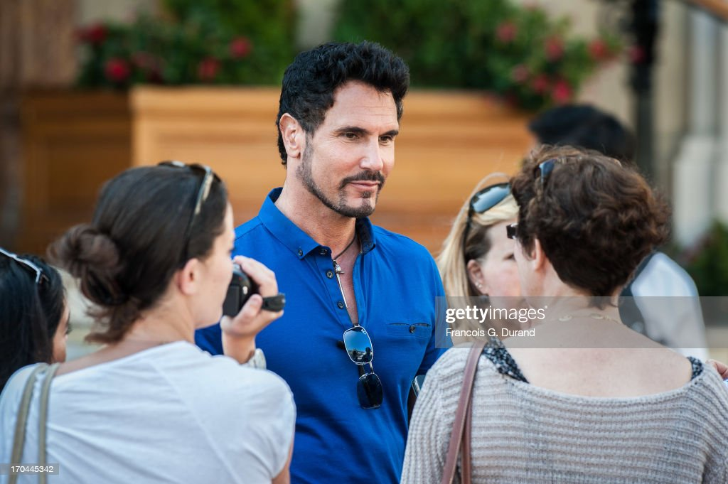Actor Don Diamont poses with journalists as he is filming a scene of 'Bold And the Beautiful' on June 13, 2013 in Monaco, Monaco.