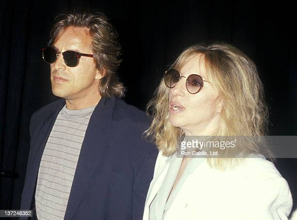 Actor Don Johnson and actress/singer Barbra Streisand attend the 14th Annual NATO/ShoWest Convention TriStar Pictures Luncheon on February 24 1988 at...