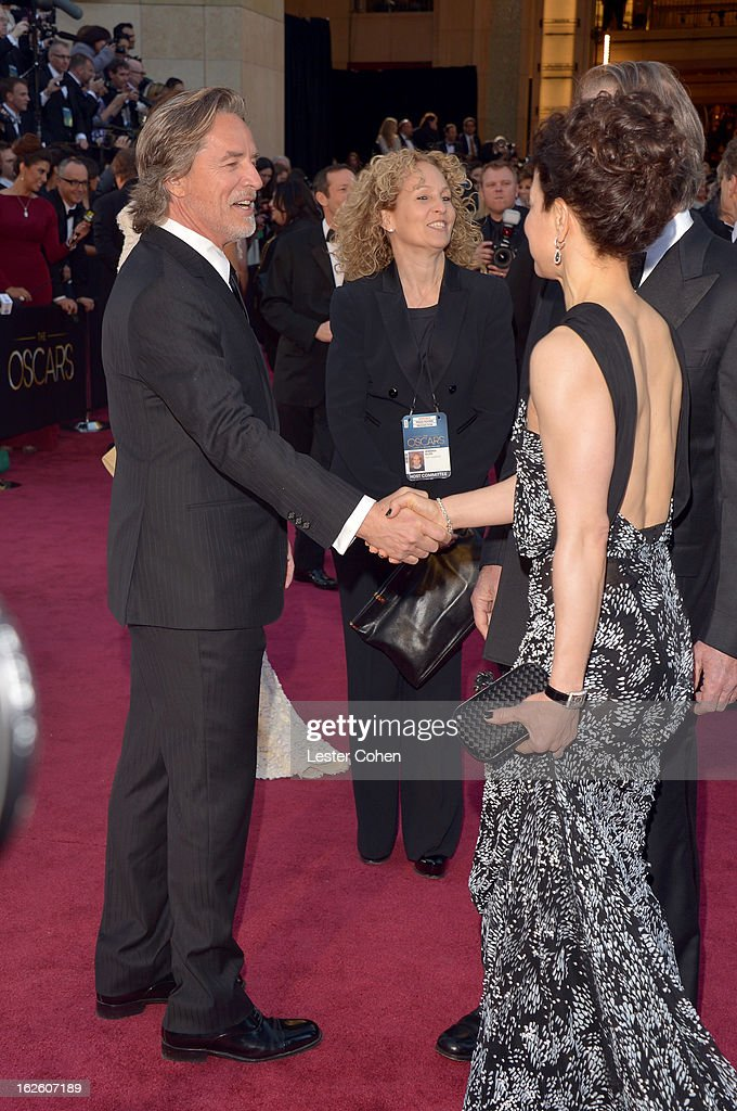 Actor Don Johnson shakes hands with Dawn Laurel-Jones as they arrive at the Oscars at Hollywood & Highland Center on February 24, 2013 in Hollywood, California.