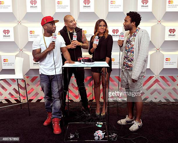 Actor Donald Glover poses with radio personalities Charlamagne Tha God DJ Envy and Angela Yee of the Breakfast Club during the 2014 iHeartRadio Music...