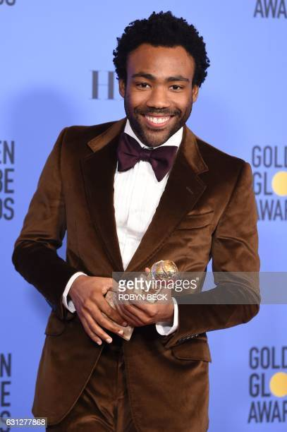 TOPSHOT Actor Donald Glover poses with the award for Best Actor in a Television Series Comedy or Musical in the press room at the 74th Annual Golden...
