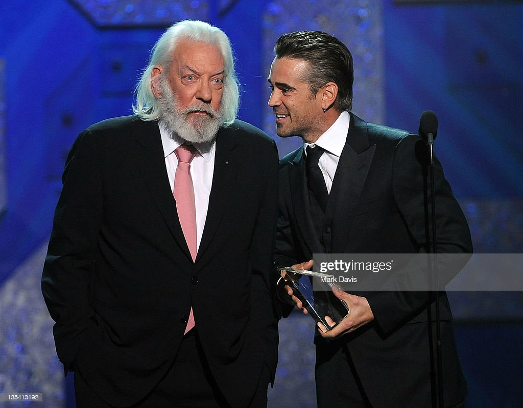 Actor Donald Sutherland presents actor Colin Farrell with an award onstage at the American Giving Awards presented by Chase held at the Dorothy...