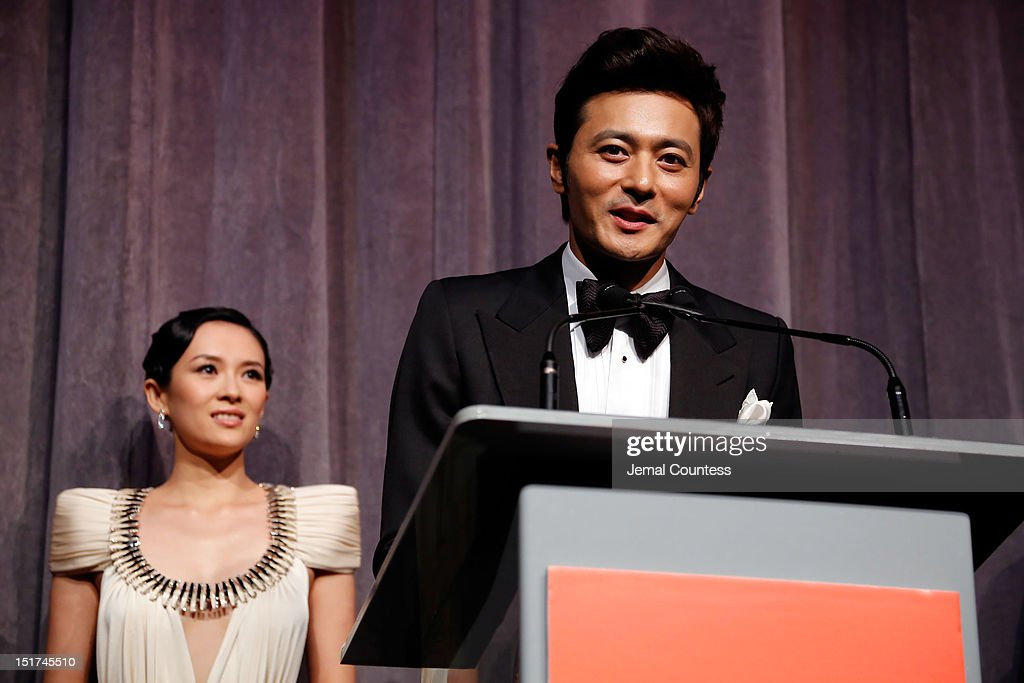 Actor Dong-gun Jang (R) and actress <a gi-track='captionPersonalityLinkClicked' href=/galleries/search?phrase=Ziyi+Zhang&family=editorial&specificpeople=172013 ng-click='$event.stopPropagation()'>Ziyi Zhang</a> on stage at the 'Dangerous Liaisons' Premiere during the 2012 Toronto International Film Festival at Roy Thomson Hall on September 10, 2012 in Toronto, Canada.