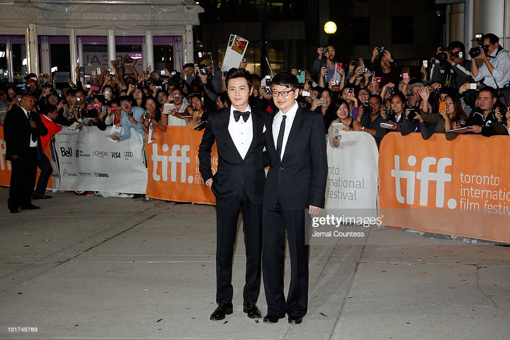 Actor Dong-gun Jang and director Hur Jin-Ho arrive at the 'Dangerous Liaisons' Premiere during the 2012 Toronto International Film Festival at Roy Thomson Hall on September 10, 2012 in Toronto, Canada.