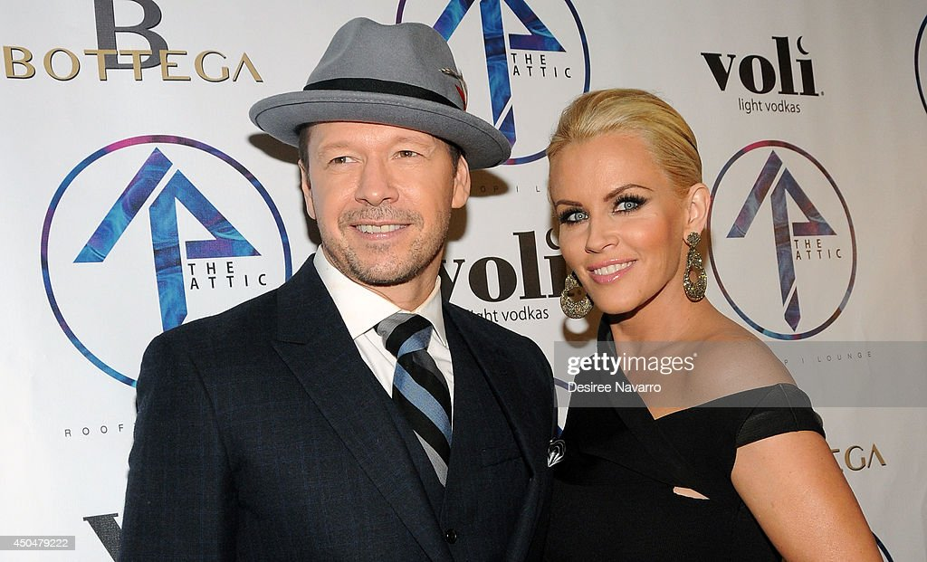 Actor <a gi-track='captionPersonalityLinkClicked' href=/galleries/search?phrase=Donnie+Wahlberg&family=editorial&specificpeople=220537 ng-click='$event.stopPropagation()'>Donnie Wahlberg</a> and TV personality <a gi-track='captionPersonalityLinkClicked' href=/galleries/search?phrase=Jenny+McCarthy&family=editorial&specificpeople=202900 ng-click='$event.stopPropagation()'>Jenny McCarthy</a> attend the grand opening of The Attic Rooftop Lounge on June 11, 2014 in New York City.