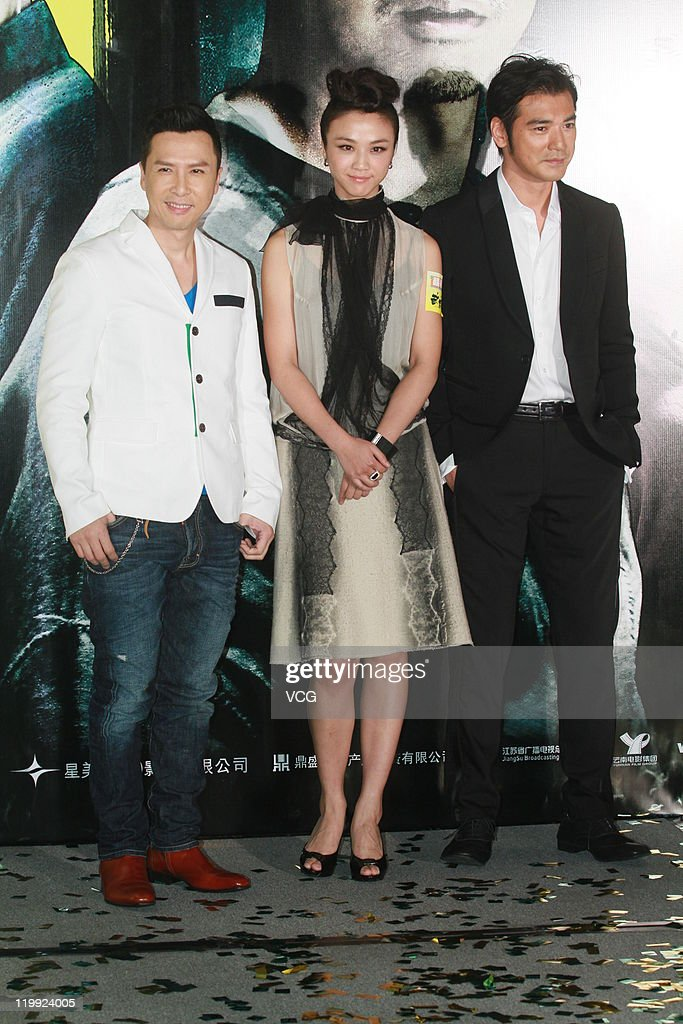 Actor <a gi-track='captionPersonalityLinkClicked' href=/galleries/search?phrase=Donnie+Yen&family=editorial&specificpeople=235559 ng-click='$event.stopPropagation()'>Donnie Yen</a>, actress <a gi-track='captionPersonalityLinkClicked' href=/galleries/search?phrase=Tang+Wei&family=editorial&specificpeople=4329520 ng-click='$event.stopPropagation()'>Tang Wei</a> and actor <a gi-track='captionPersonalityLinkClicked' href=/galleries/search?phrase=Takeshi+Kaneshiro&family=editorial&specificpeople=171924 ng-click='$event.stopPropagation()'>Takeshi Kaneshiro</a> attends 'Wu Xia' movie premiere on July 26, 2011 in Hong Kong, China.
