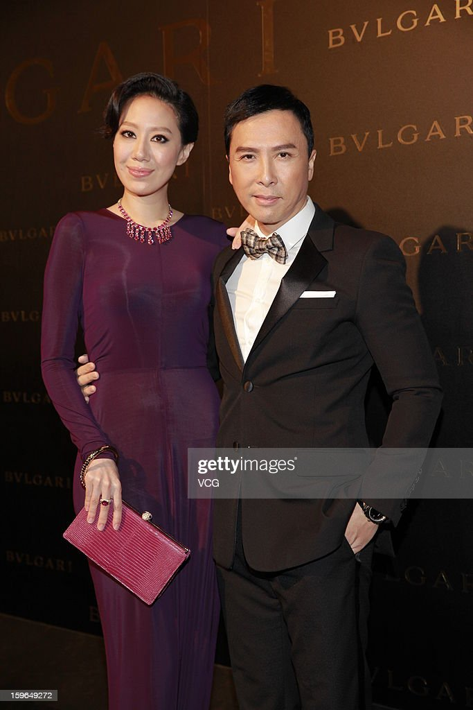 Actor <a gi-track='captionPersonalityLinkClicked' href=/galleries/search?phrase=Donnie+Yen&family=editorial&specificpeople=235559 ng-click='$event.stopPropagation()'>Donnie Yen</a> (R) and his wife Cissy Wang attend Bulgari store opening reception on January 17, 2013 in Hong Kong, Hong Kong.
