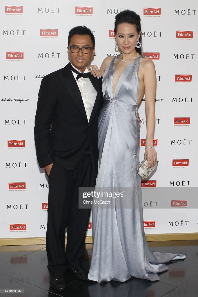 Actor Donnie Yen and wife Cissy Wang pose on arrival at the Power of Film Gala at the Grand Hyatt Hong Kong's Grand Ballroom on March 18 2012 in Hong...