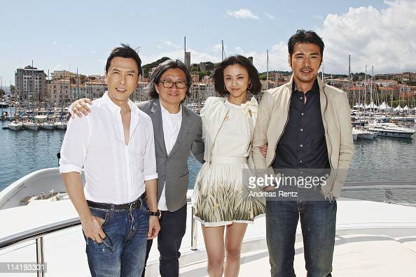 Actor Donnie Yen director Peter Chan actress Tang Wei and actor Takeshi Kaneshiro pose at the 'Wu Xia' portrait session during the 64th Annual Cannes...