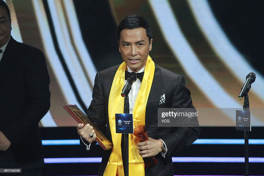 Actor Donnie Yen receives award from the 15th Huading Awards during on January 2015 in Macau China