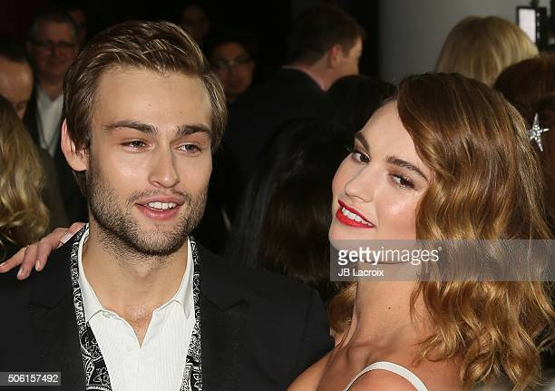 Actor Douglas Booth and actress Lily James attend the premiere of Screen Gems' 'Pride and Prejudice and Zombies' on January 21 2016 in Los Angeles...