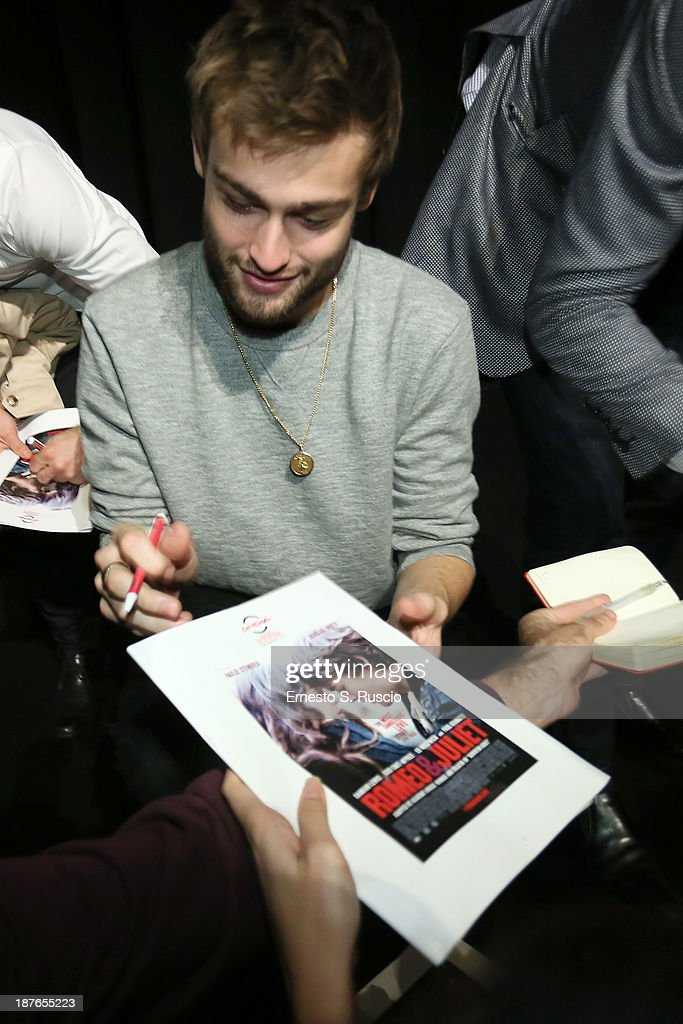 Actor Douglas Booth signs autographs as he attends the 'Romeo And Juliet' Press Conference during the 8th Rome Film Festival at the Auditorium Parco Della Musica on November 11, 2013 in Rome, Italy.