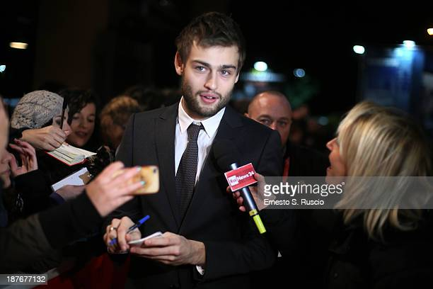 Actor Douglas Booth talks to reporter as he attends 'Romeo And Juliet' Premiere during The 8th Rome Film Festival at Auditorium Parco Della Musica on...