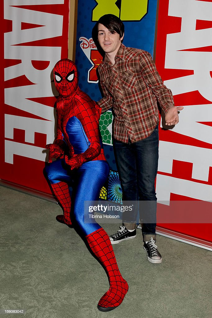 Actor Drake Bell (R) and Spiderman attend 'Reading With: Marvel Comics Close-Up' kick-off event at the Burbank Public Library on January 12, 2013 in Burbank, California.