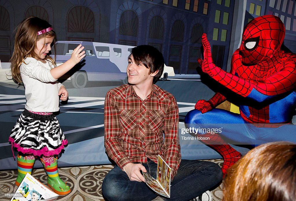 Actor Drake Bell (C) reads to a group of children at the 'Reading With: Marvel Comics Close-Up' kick-off event at the Burbank Public Library on January 12, 2013 in Burbank, California.