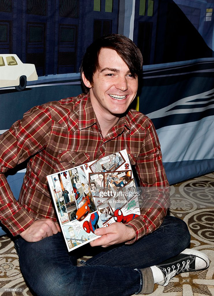 Actor Drake Bell reads to a group of children at the 'Reading With: Marvel Comics Close-Up' kick-off event at the Burbank Public Library on January 12, 2013 in Burbank, California.