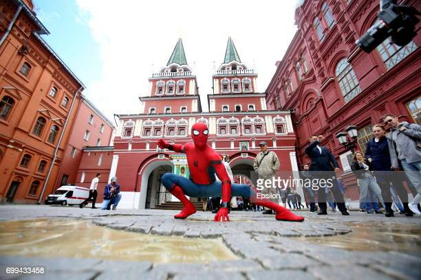 Actor dressed in the authentic spiderman costume poses for a picture in front of the Revolution Museum to support SpiderMan Homecoming on June 21...