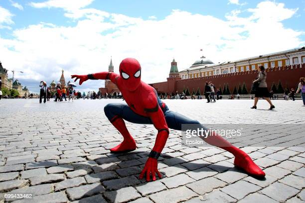 Actor dressed in the authentic spiderman costume poses for a picture on the Red Square to support SpiderMan Homecoming on June 21 2017 in Moscow...
