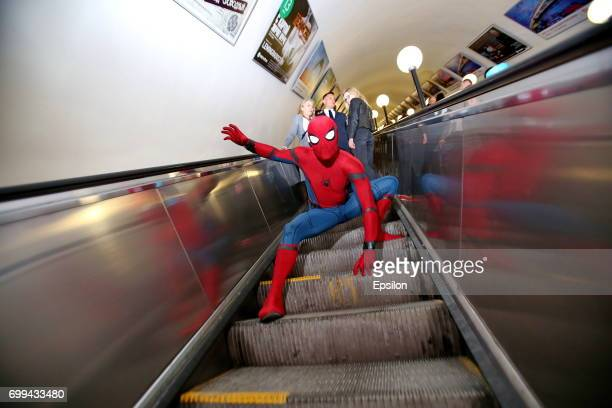 Actor dressed in the authentic spiderman costume poses for a picture in a subway to support SpiderMan Homecoming on June 21 2017 in Moscow Russia