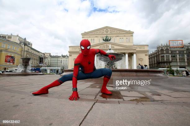 Actor dressed in the the authentic spiderman costume poses for a picture in front of Bolshoy Theatre to support SpiderMan Homecoming on June 21 2017...