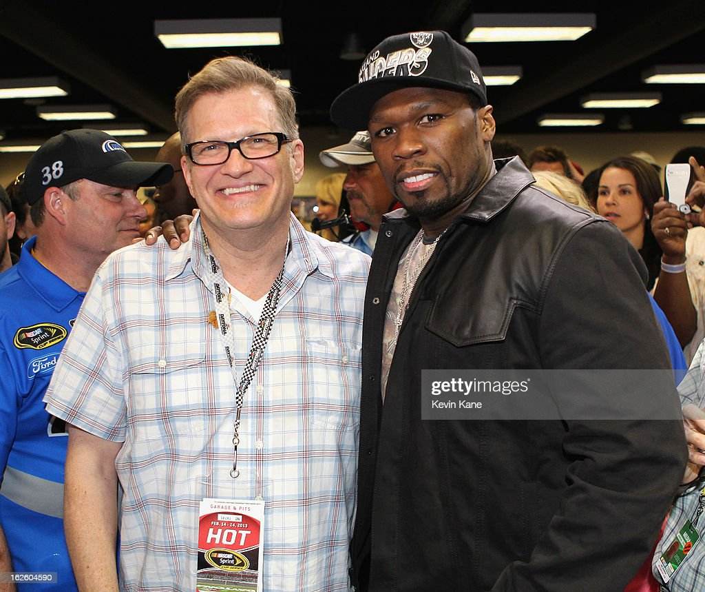 Actor Drew Carrey and Rapper <a gi-track='captionPersonalityLinkClicked' href=/galleries/search?phrase=50+Cent+-+Rapper&family=editorial&specificpeople=215363 ng-click='$event.stopPropagation()'>50 Cent</a> prior to the start of the Daytona 500 at Daytona International Speedway on February 24, 2013 in Daytona Beach, Florida.