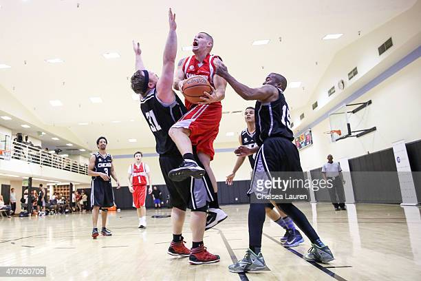 Actor Drew Powell actor Greg Finley actor Cory Hardrict and talent manager Silas White attend the ELeague celebrity basketball league game at Equinox...