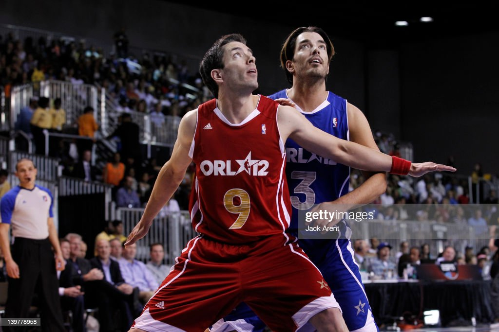 Actor Drew Scott and Actor Jonathan Scott battle for position during the Sprint All-Star Celebrity Game on center court at Jam Session during the NBA All-Star Weekend on February 24, 2012 at the Orange County Convention Center in Orlando, Florida.