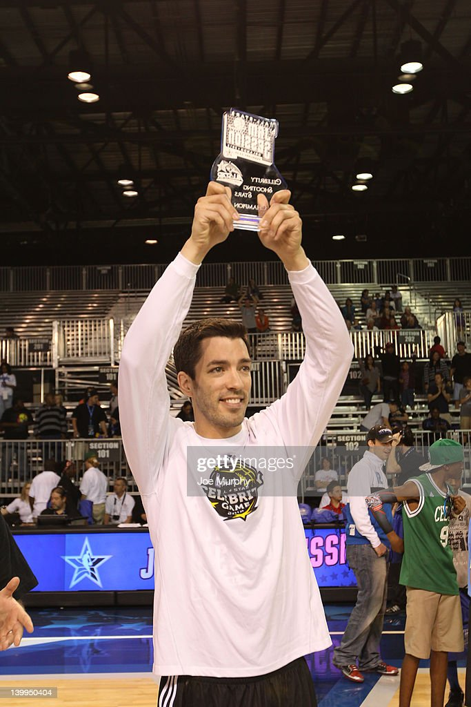 Actor Drew Scott celebrates winning after the Celebrity Shooting Stars on center court at Jam Session during the NBA All-Star Weekend on February 26, 2012 at the Orange County Convention Center in Orlando, Florida.