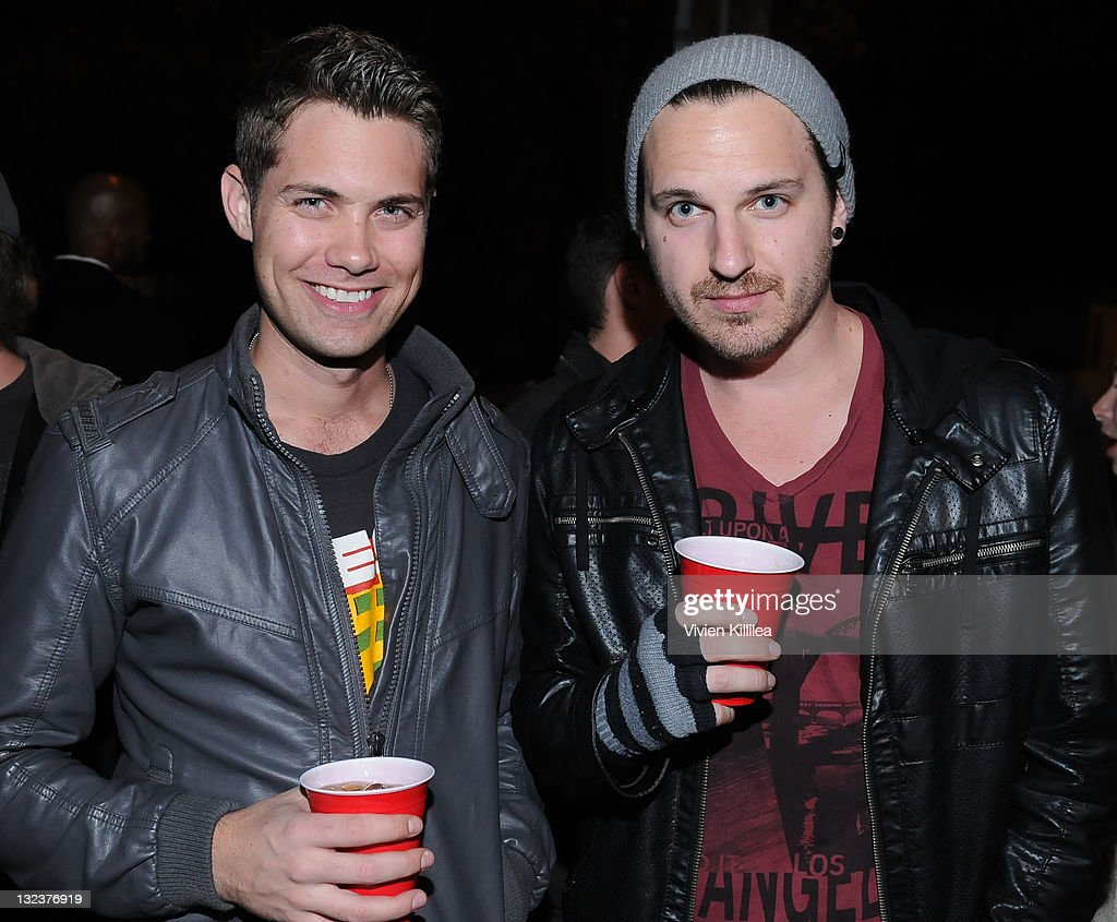 Actor <a gi-track='captionPersonalityLinkClicked' href=/galleries/search?phrase=Drew+Seeley&family=editorial&specificpeople=835160 ng-click='$event.stopPropagation()'>Drew Seeley</a> and music producer Brandon Slavinski attend the PERRI INK. Cartel Store Opening on November 11, 2011 in Los Angeles, California.