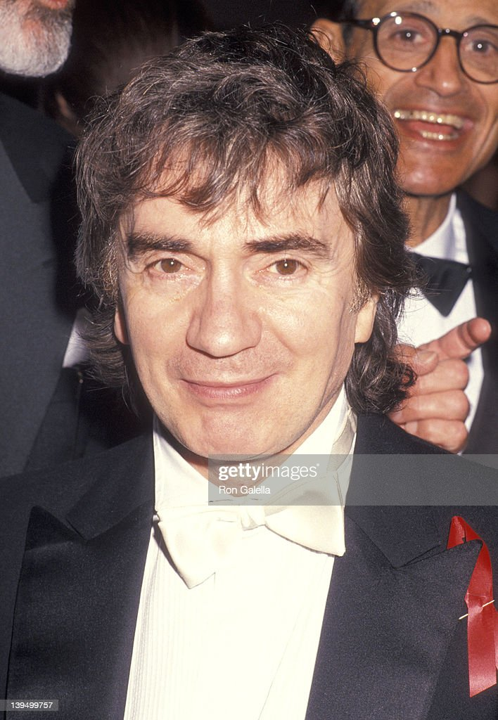 Actor <a gi-track='captionPersonalityLinkClicked' href=/galleries/search?phrase=Dudley+Moore&family=editorial&specificpeople=209351 ng-click='$event.stopPropagation()'>Dudley Moore</a> attends the New World Symphony Benefit Gala on March 13, 1994 at The Omni Hotel in Miami, Florida.