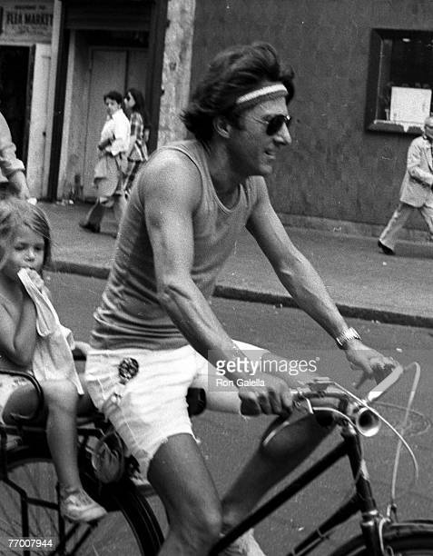 Actor Dustin Hoffman and daughter being photographed riding his bike on April 18 1976 on West 44th Street in New York City New York