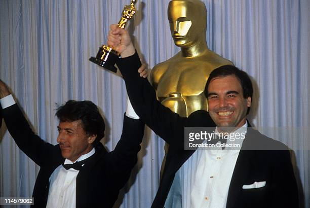 Actor Dustin Hoffman and Director Oliver Stone at Academy Awards in March 1987 in Los Angeles California