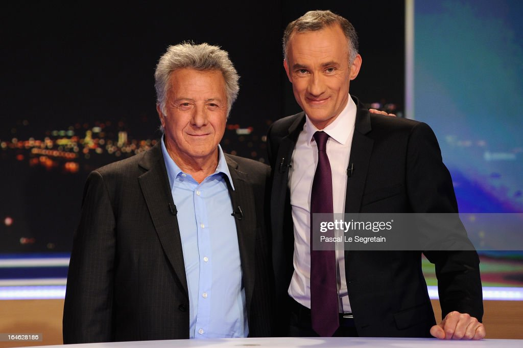Actor <a gi-track='captionPersonalityLinkClicked' href=/galleries/search?phrase=Dustin+Hoffman&family=editorial&specificpeople=171356 ng-click='$event.stopPropagation()'>Dustin Hoffman</a> (L) and journalist Gilles Bouleau (R) attend on the TV set of French channel TF1 prior to an interview, part of the evening news broadcast on March 25, 2013 in Boulogne-Billancourt, France.