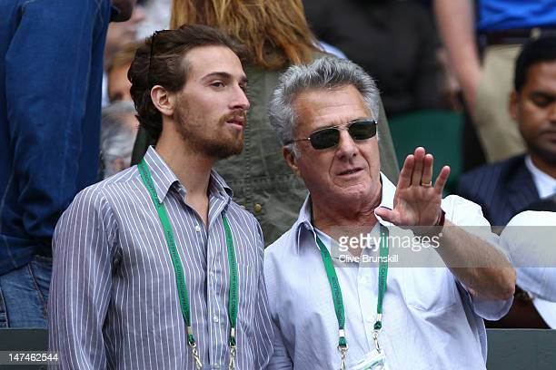 Actor Dustin Hoffman and sone Jake Hoffman attend the Ladies' Singles third round match Serena Williams of the USA and Jie Zheng of China on day six...