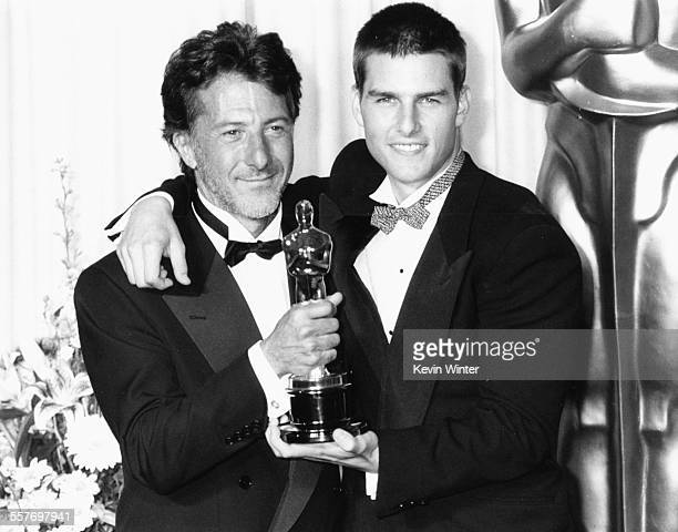 Actor Dustin Hoffman holding his Oscar with his 'Rain Man' costar Tom Cruise at the 61st Annual Academy Awards at the Shrine Auditorium in Los...