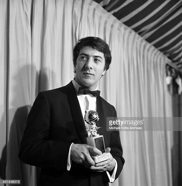 Actor Dustin Hoffman poses with a Golden Globe award for Most Promising Newcomer Male in Los Angeles California