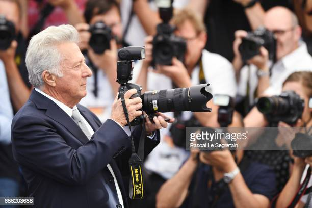 Actor Dustin Hoffman takes a picture as he attends the 'The Meyerowitz Stories' photocall during the 70th annual Cannes Film Festival at Palais des...